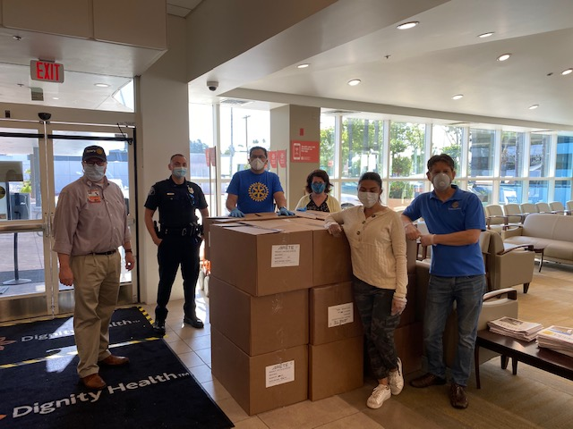 Hospital Staff accepting donation to Glendale Memorial